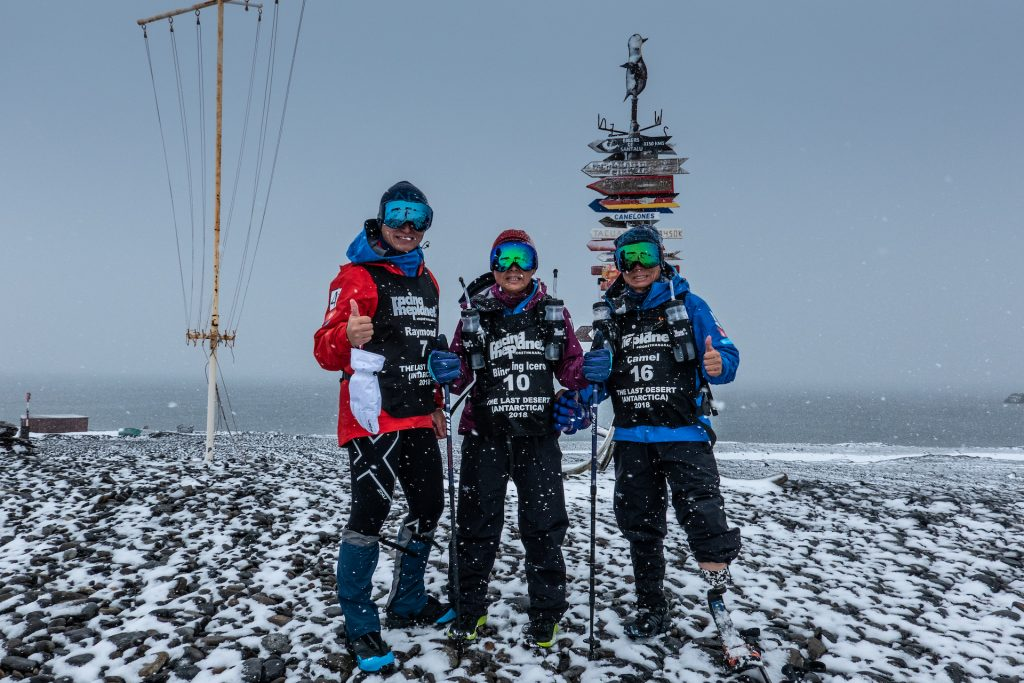 "The ""Five Legs Never Quit"" Team posing during their race in the Antartica."